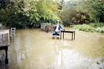Wayside Cottage resident Brian Watson, in flooded Tea Gardens in 1975.