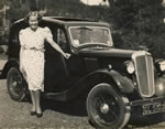Evelyn with her Austin at The Mead during the War; regularly raising funds for the war effort at The Tea Gardens with St. Catherine's parishioners and running 5 successful businesses - 600 would have tea at The Mead at a weekend. Huge endeavour and team work!